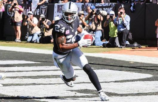 Raiders safety Charles Woodson intercepted the ball.  (Oakland Raiders photo)