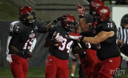 Michael Gordon's teammates congratulate him after scoring a touchdown Saturday. (ASU Photo)