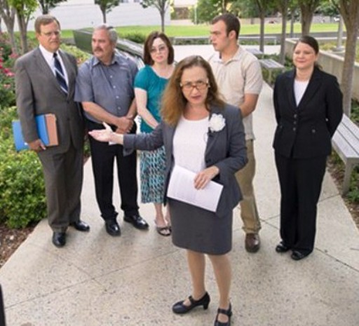 Arkansas ACLU Executive Director Rita Sklar earlier discussed the lawsuit they were filing. From left, in background, are attorney Pat James, Ronald, Eva and Matthew Robinson, and ACLU staff attorney Holly Dickson.