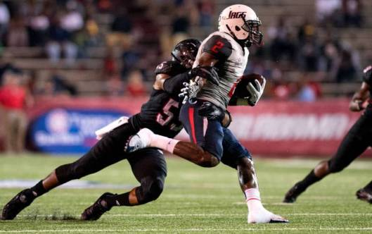 Linebacker Xavier Woodson-Luster tackles Jaguar Danny Woodson.  Woodson-Luster led the Red Wolves in defense with 9.5 tackles. (ASU Photo)