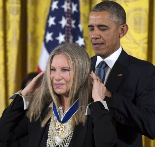 Barbra Streisand accepts the Presidential Medal of Freedom. (Voice of America photo)
