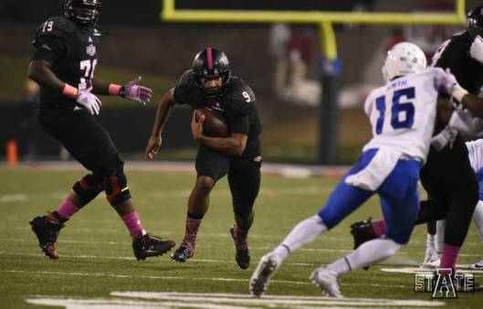 A run by ASU quarterback Fredi Knighten, No. 9, scored the Red Wolves first touchdown in their game against the Georgia State Panthers Saturday night.  (ASU Photo)