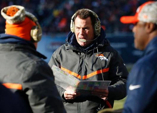 Broncos Head Coach Gary Kubiak talks things over with his assistants Sunday. (Denver Broncos photo)