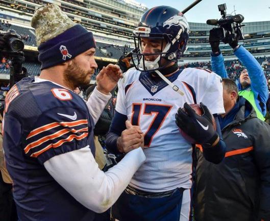 Bears quarterback Jay Cutler reluctantly congratulates Broncos quarterback Brock Osweiler on his win Sunday. (Denver Broncos photo)