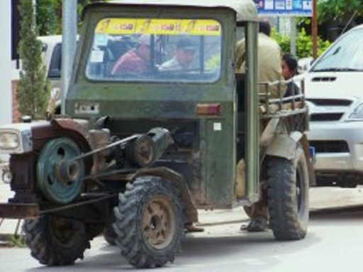 Creative mechanics keep these Vietnam War-era trucks in service.  (Luang Nam Tha, Laos)