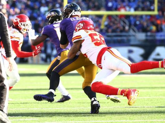 Ravens quarterback Jimmy Clausen is sacked by cornerback Derrick Johnson.  (Kansas City Chiefs photo)