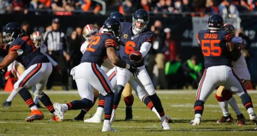 Bears running back Matt Forte gets the ball from quarterback Jay Cutler Sunday. (Chicago Bears photo)