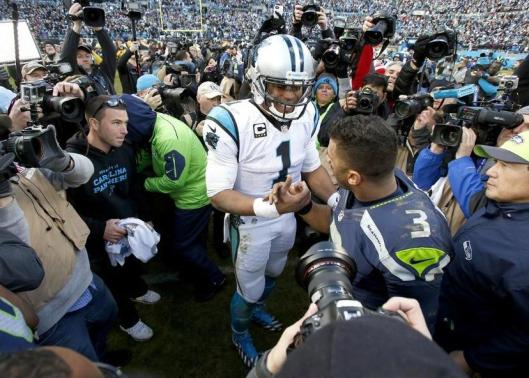Panthers quarterback Cam Newton greets Seahawks quarterback Russell Wilson after the game Sunday. (Carolina Panthers photo)