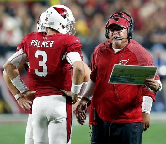 Cardinals Coach Bruce Arians talks things over with quarterback Carson Palmer. (Arizona Cardinals photo)