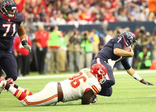 Chiefs defensive lineman Jaye Howard sacks Texan quarterback Brian Moyers. (Kansas City Chiefs photo)