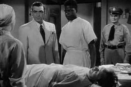 Stephen McNally as Dr. Dan Wharton and Sidney Poitier as Dr. Luther Brooks with Dick Paxton as Johnny Biddle on the bed.