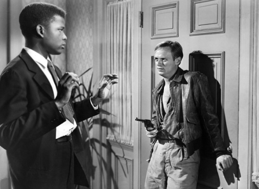 Near the end of the movie, Ray Biddle, played by Richard Widmark, is ready to kill Dr. Luther Brooks, played by Sidney Poitier.
