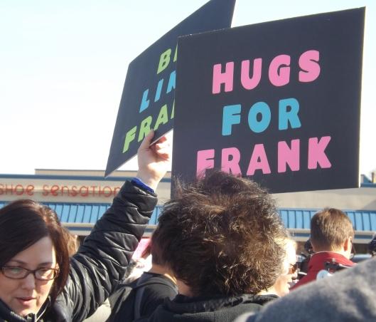 Hugs for Frank. (Staff photo by Mariann Hyslop)