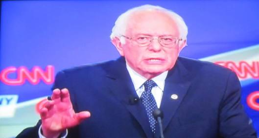 Bernie Sanders  (Hill 'n Holler photo of CNN debate broadcast on line)