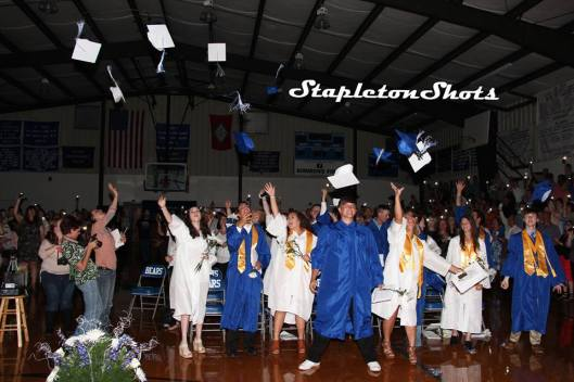It was time for the Mammoth Spring High School graduates to toss their hats in the air, in the dark Monday night, as audience members lit the gym with their cell phones. (Facebook photo from Stapleton Shots)