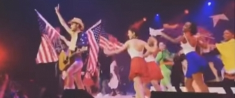 A youth pastor pretends to be The Naked Cowboy during a church women's conference.