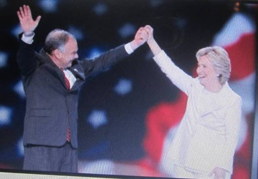 Vice presidential nominee Tim Kaine and Hillary Clinton after Hillary's speech Thursday night.  (Hill 'n Holler photo from official DNC 2016 live stream)