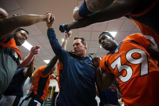 Broncos Head Coach Gary Kubiak congratulates his team after their win Saturday. (Denver Broncos photo by Gabriel Christus)