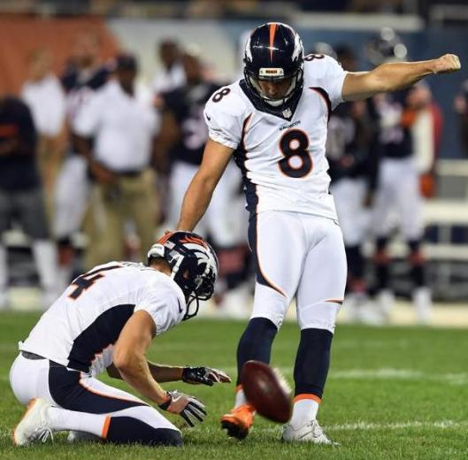 Brandon McManus kicked two field goals in the second quarter Thursday night. With him is Britton Colquitt. (Denver Broncos photo by Eric Bakke)