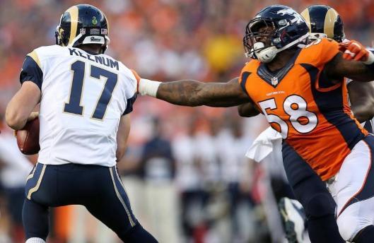 Linebacker Von Miller takes on Rams quarterback Case Keenum. (Denver Broncos photo by Gabriel Christus)