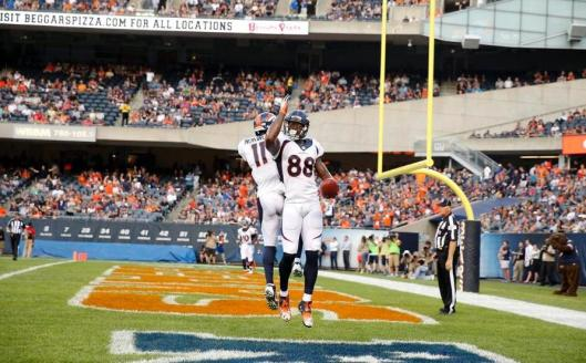Wide receiver Demaryius Thomas scored the first Broncos touchdown Thursday night. Behind him is Jordan Norwood.  (Denver Broncos photo by Steve Woltmann)