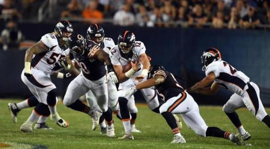 Rookie quarterback Paxton Lynch completed 6-7 passes for 74 yards Thursday but was sacked three times. (Denver Broncos photo by Eric Bakke)