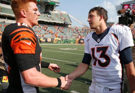 Bengals quarterback Andy Dalton talks to Trevor Siemian after the game Sunday. (Denver Broncos photo by Eric Bakke)