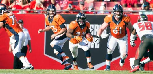 Running Back C.J. Anderson scored the Broncos second touchdown in the second quarter Sunday. He led the team in rushing with with 19 carries for 49 yards. (Denver Broncos photo by Eric Bakke)