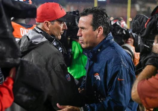 Buccaneers Coach Dirk Koetter and Broncos Coach Gary Kubiak talk after the game Sunday. (Denver Broncos photo by Eric Bakke)