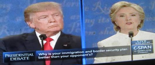 Donald Trump listens to Hillary Clinton talking about immigration during the debate Wednesday night. (Hill 'n Holler photo from C-SPAN live stream)