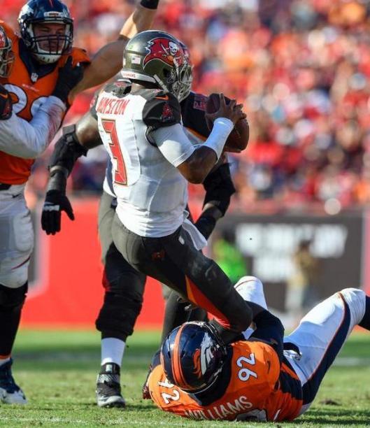 Buccaneers quarterback Jameis Winston is sacked by Sylvester Williams. Winston was sacked five times Sunday.  (Denver Broncos photo by Eric Bakke)