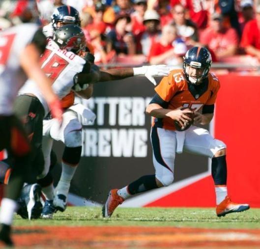Quarterback Trevor Siemian runs with the ball Sunday. (Denver Broncos photo by Eric Bakke)