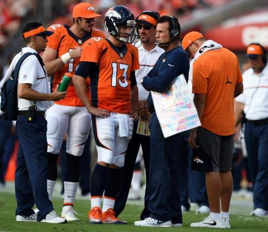 Trevor Siemian and Coach Gary Kubiak talk during thr game Sunday. (Denver Broncos photo by Eric Bakke)