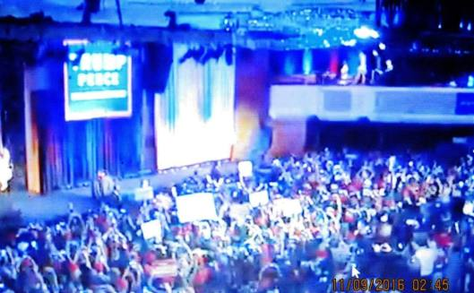The scene of the4 victory celebration for Donald Trump early Wednesday morning. (Hill 'n Holler photo from cbsnews.com live stream)