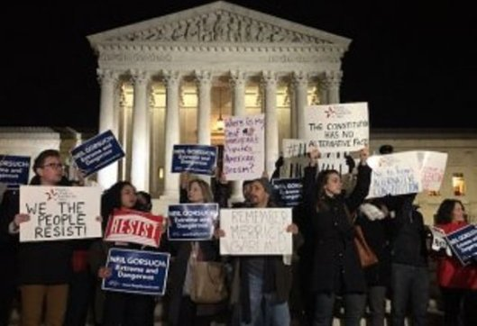 Protesters gathered at the Supreme Court after the nomination of Neil Gorsuch was announced. (alternet.org photo by Jeff Morley)