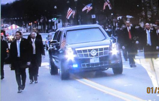 The new President is escorted to the parade viewing stand. (Hill 'n Holler photo from CBS News live stream)